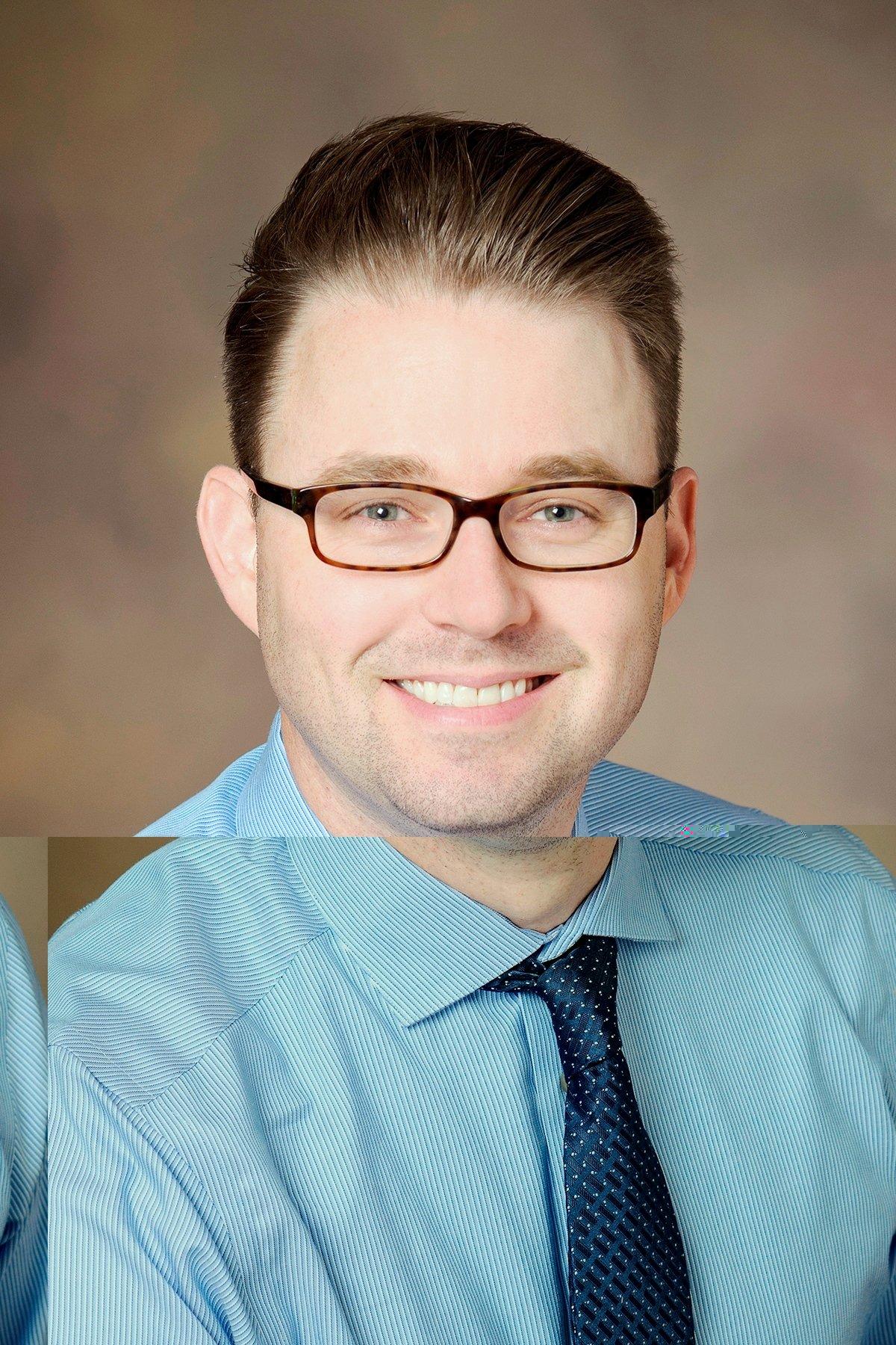 Aaron Scott, M.D.